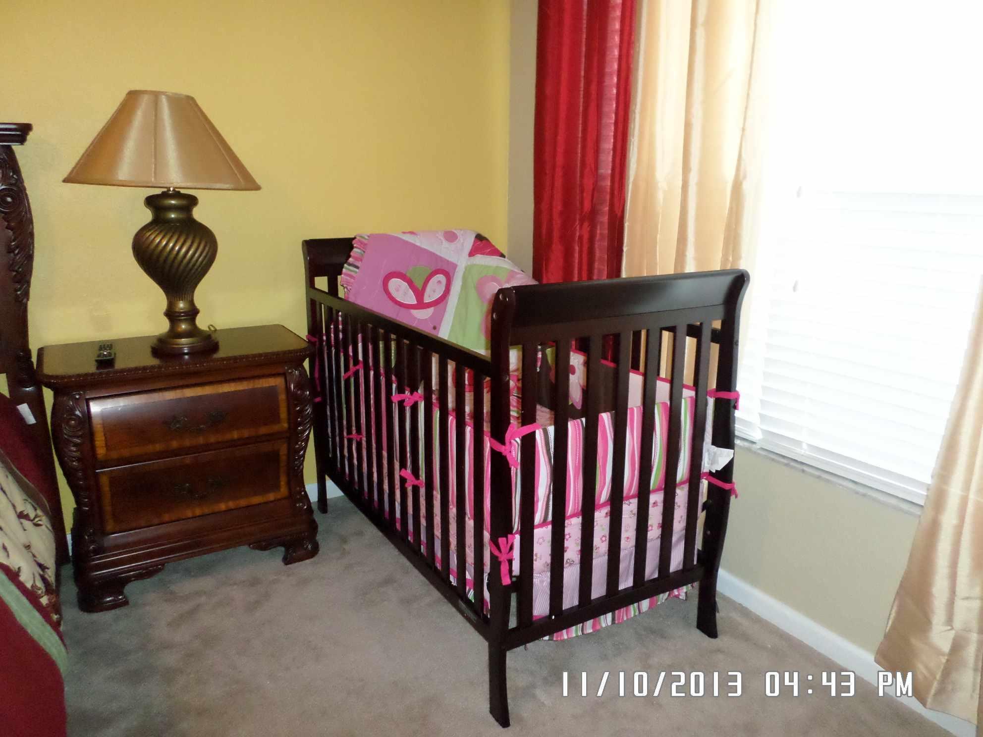 full size crib in bedroom 1